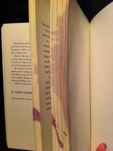 First, Paulie spilled his wine on my book